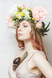 Calm pretty girl with snail and flower crown. On head on white background Royalty Free Stock Photo
