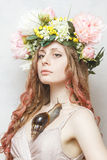 Calm pretty girl with snail and flower crown. On head on white background Stock Photo