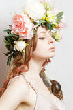 Calm pretty girl with snail and flower crown. On head on white background Stock Image