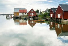 Calm private port. Wide-angle image of a small private harbor reflecting timber houses Royalty Free Stock Photo
