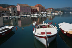 Calm and reflective harbor water. Royalty Free Stock Photography