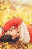 Calm relaxed woman profile portrait, take a rest lying in autumn  leaves in park, closed eyes Royalty Free Stock Photography
