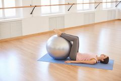 Exercising with swiss ball stock image