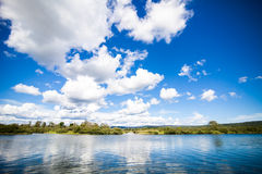 Calm River and Amazing Blue Sky Stock Photo