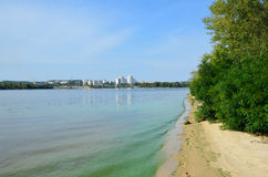 Calm river with green riverbank Royalty Free Stock Photo