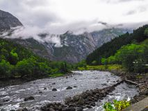 Calm River Near Mountains Stock Images