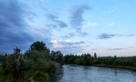 calm river at sunset royalty free stock images