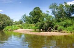 Calm river under blue sky Stock Photo