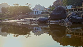 Calm River Water Reflects Old Indian Town on Bank stock video footage