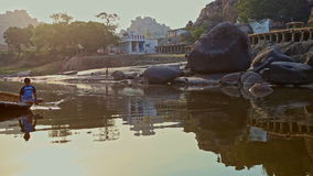 Calm River Water Ripples against Old Indian Town on Flat Bank stock footage