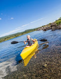 Calm River and Woman Kayaking in Gaspe Stock Photo