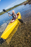 Calm River and Woman Kayaking in Gaspe Stock Image