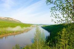 A calm river in the yukon territories Royalty Free Stock Image