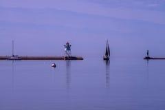 Calm sailing, grand marais lighthouse Stock Photo