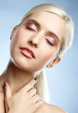 Calm satisfaction. Young blond adult lady's face with her eyes closed, and a hand Stock Images