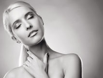 Calm satisfaction. Young blond adult lady's face with her eyes closed, and a hand Royalty Free Stock Images