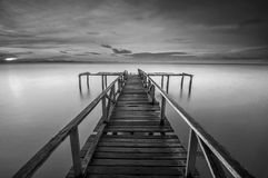 Calm scene in black and white. With abandoned jetty at Teluk Tempoyak, Penang, Malaysia. black and white (fine art Royalty Free Stock Photo