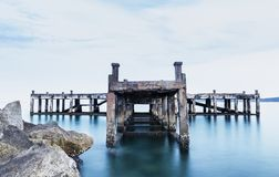 Calm scene detail of old jetty Royalty Free Stock Images