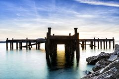 Calm scene detail of old jetty royalty free stock image