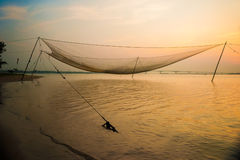 Calm scene of fishing net against purple sunset Royalty Free Stock Images