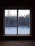 Calm Scene of Winter Nature Through the Window Pane. Calm Scene of Nature during Winter through the Window Pane of a Shack on a Cold Morning Royalty Free Stock Photography
