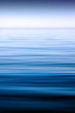 Calm sea. A scene with calm sea extending to the horizon, under the clear sky royalty free stock photos