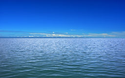 Calm sea and blue clear sky Royalty Free Stock Images