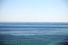 Calm sea and blue clear sky Stock Photos