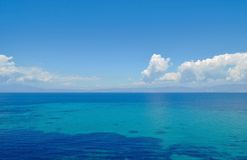 Calm sea and blue sky Stock Photography