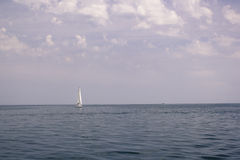 Calm sea. With a boat far Royalty Free Stock Images