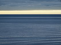 Calm sea. Before a cloudy evening sky Stock Photo