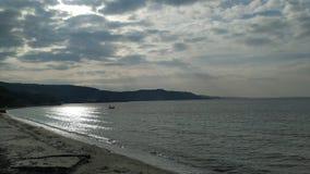 Calm sea cloudy sky. Shore beautiful day royalty free stock photos