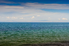 Calm Sea With Cloudy Sky And Islands Royalty Free Stock Photo