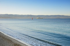 Calm sea with a distant ferry in the bay of Ajaccio Royalty Free Stock Photos