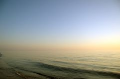 Calm sea in the evening, clear sky Royalty Free Stock Images