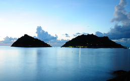 Calm sea and island at night Stock Photography