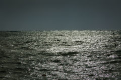 The calm sea before a night storm. Stock Image