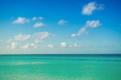 Calm sea, ocean and blue cloudy sky. Horizon. Picturesque Seascape.  royalty free stock image