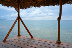 Calm sea from a palapa over water Royalty Free Stock Images