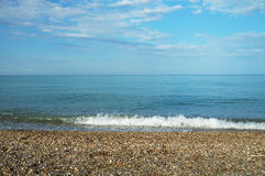 Calm sea with pebble coast Royalty Free Stock Photos