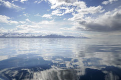 Calm sea reflecting clouds Royalty Free Stock Photography