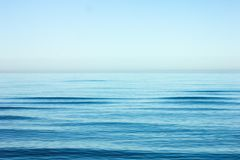 Calm sea ripple with horizon over water royalty free stock photo