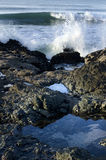 Calm sea rock and powerful waves Stock Photography