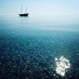 Calm Sea with a Sailing Vessel. Morning. Sailing ship profile. Stock Images