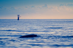 Calm sea scape with buoyancy. Calm sea scape in the morning sun set with buoyancy Royalty Free Stock Photo