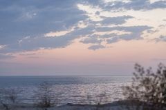 Calm  sea shore in rays of sunset sky.  Pink color of the sky. Silence, relaxation.  Stock Image