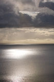Calm Sea Sky. Calm sea with dark threatening storm clouds overhead Stock Images