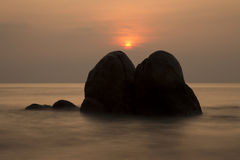 Calm sea, sunrise and rocks Royalty Free Stock Photography