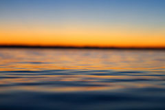 Calm Sea during Sunset Stock Photos