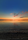 Calm sea at sunset. Calm sea in Alghero at sunset Royalty Free Stock Photo